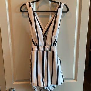 Plunge v cross back black and white striped romper